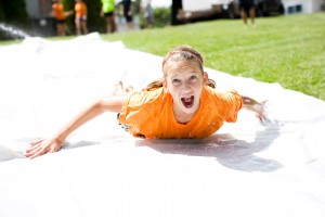 Water slide on our church lawn during Summer Kids Club